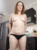 Gloria G strips naked in her kitchen