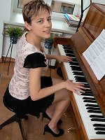 Calina strips naked while playing her piano